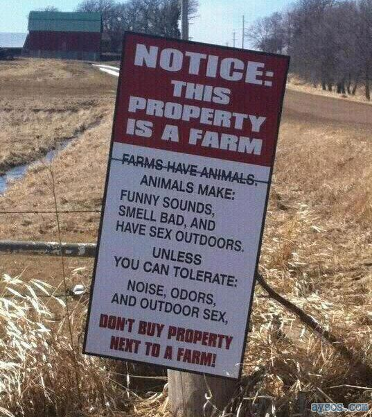 Funny sign about living near farms