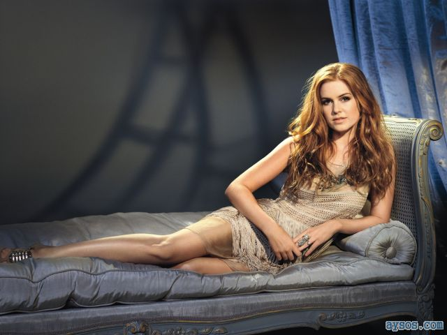 Hot Isla Fisher dressed up in bed