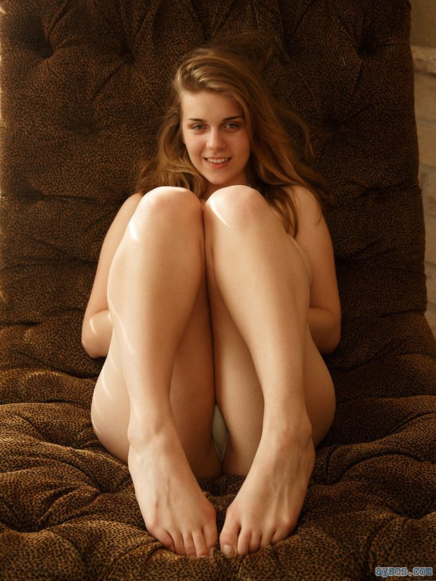 Shy but sexy babe posing for the camera with her cute legs