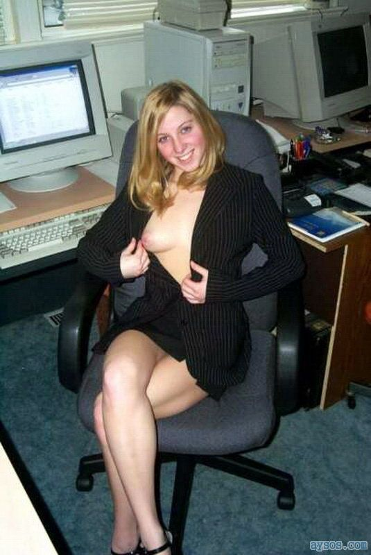 Sexy secretary pulls open her blouse to show boobs