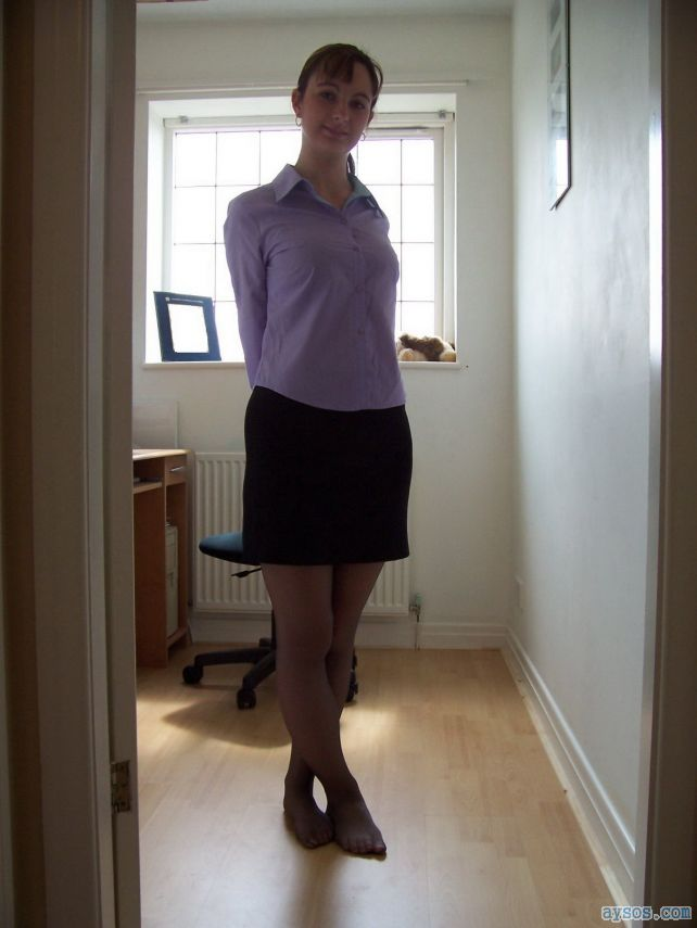 A very cute wife showing off her sexy body in a short skirt and black pantyhose for the camera