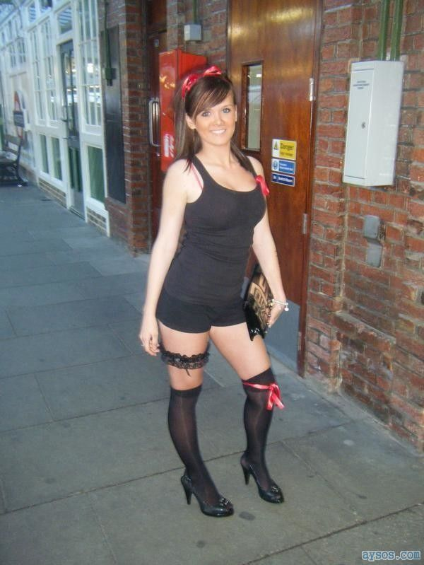 Cute lady posing in sexy knee high socks