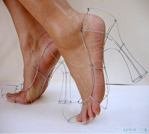 Feet in heels made of wire