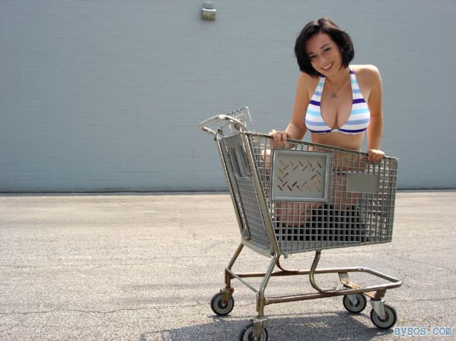 Sexy Crystal in a cart showing her big boobs