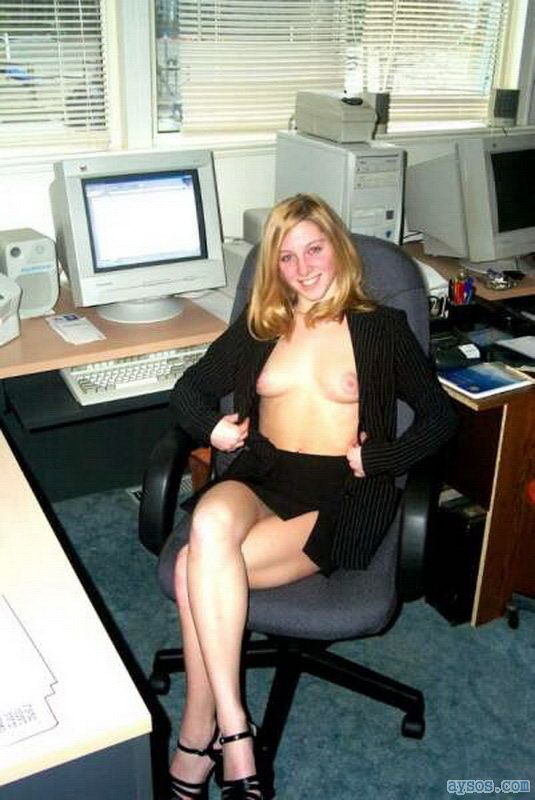Cute office babe flashing her tits