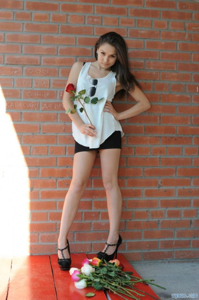 Hot girl with very long legs in sexy heels