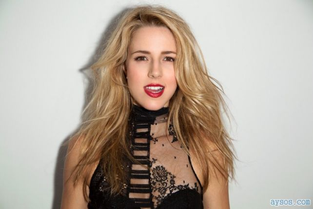 Alona Tal teasing us with her sheer dress and bright red lips while biting her tongue
