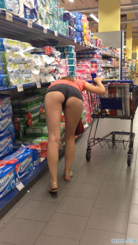 Shopping wife bending over to show her ass