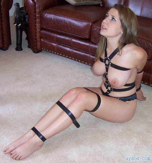 Sexy babe gets tied up and looks scared