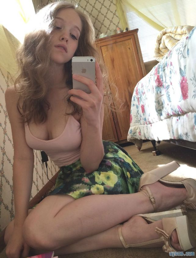 Cute girl takes a sexy selfie in her heels