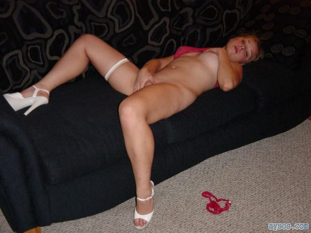 Hot wife spreads on the couch in sexy heels